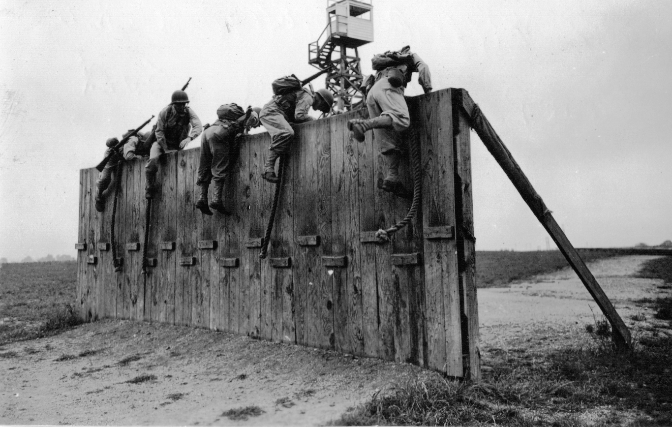 soldiers scaling wall
